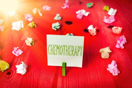 Handwriting text Chemotherapy. Conceptual photo the treatment of disease by the use of chemical substances Colored crumpled rectangle shaped reminder paper light blue background Reklamní fotografie