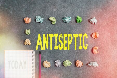 Word writing text Antiseptic. Business photo showcasing antimicrobial agents that delays or completely eliminate the microorganism Paper accesories with digital smartphone arranged on different background Stock fotó