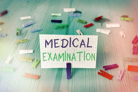 Conceptual hand writing showing Medical Examination. Concept meaning the examination carried out to determine physical fitness Colored crumpled rectangle shape paper light blue background