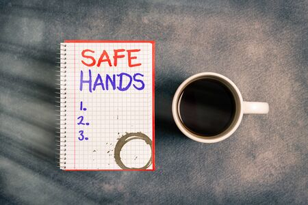 Text sign showing Safe Hands. Business photo text Ensuring the sterility and cleanliness of the hands for decontamination Paper accesories with digital smartphone arranged on different background