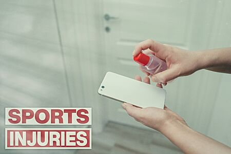 Writing note showing Sports Injuries. Business concept for injuries that occur when engaging in sports or exercise Contaminated electronic gadgets controlled by disinfectant