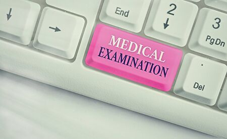 Word writing text Medical Examination. Business photo showcasing the examination carried out to determine physical fitness White pc keyboard with empty note paper above white key copy space