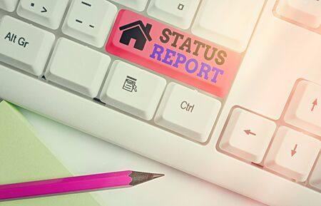 Writing note showing Status Report. Business concept for summarizes the particular situation as of a stated period White pc keyboard with empty note paper above white key copy space