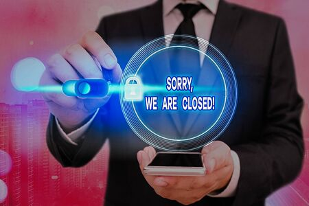 Writing note showing Sorry, We Are Closed. Business concept for apologize for shutting off business for specific time Graphics padlock for web data information security application system