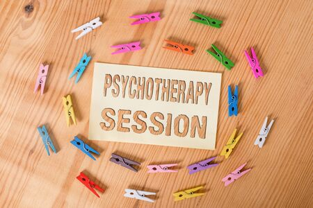 Text sign showing Psychotherapy Session. Business photo showcasing series of meetings in treating mental health problems Colored clothespin papers empty reminder wooden floor background office