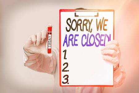 Conceptual hand writing showing Sorry, We Are Closed. Concept meaning apologize for shutting off business for specific time Laboratory blood test sample for medical diagnostic analysis