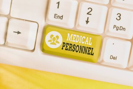 Conceptual hand writing showing Medical Personnel. Concept meaning trusted healthcare service provider allowed to treat illness White pc keyboard with empty note paper above white key copy space