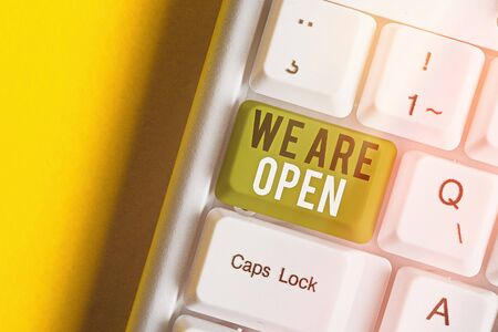 Text sign showing We Are Open. Business photo text no enclosing or confining barrier, accessible on all sides White pc keyboard with empty note paper above white key copy space