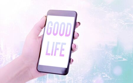 Conceptual hand writing showing Good Life. Concept meaning living in comfort and luxury with few problems or worries Modern gadgets white screen under colorful bokeh background