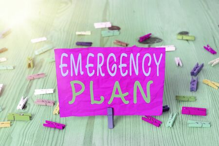 Handwriting text writing Emergency Plan. Conceptual photo instructions that outlines what workers should do in danger Colored crumpled rectangle shaped reminder paper light blue background