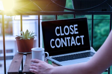 Text sign showing Close Contact. Business photo text having a history of direct exposure to a casepatient Personal workplace overview with laptop device used for individual interest