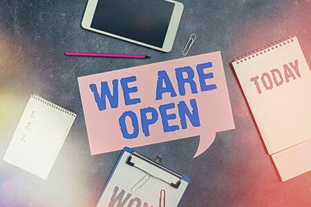 Word writing text We Are Open. Business photo showcasing no enclosing or confining barrier, accessible on all sides Paper accesories with digital smartphone arranged on different background