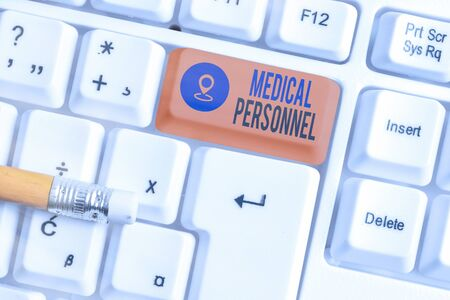 Writing note showing Medical Personnel. Business concept for trusted healthcare service provider allowed to treat illness White pc keyboard with empty note paper above white key copy space Stok Fotoğraf