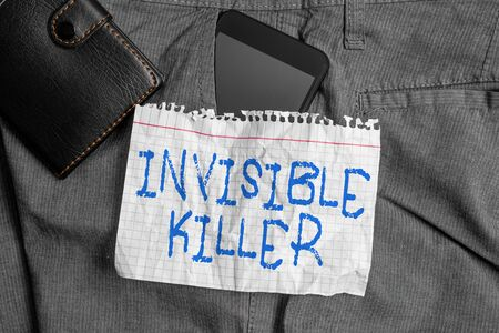 Word writing text Invisible Killer. Business photo showcasing presence into the air of a substance which are harmful Smartphone device inside trousers front pocket with wallet and note paper