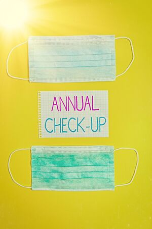 Conceptual hand writing showing Annual Checkup. Concept meaning yearly reproductive health visit with a health care provider Set of medical equipment with notepad for health assessment Stock Photo