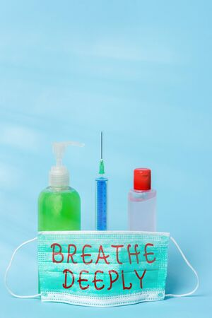 Word writing text Breathe Deeply. Business photo showcasing to take a lot of air into the lungs inhaleexhale fully Primary medical precautionary equipments for health care protection
