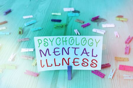 Conceptual hand writing showing Psychology Mental Illness. Concept meaning a behavioral pattern that causes significant distress Colored crumpled rectangle shape paper light blue background