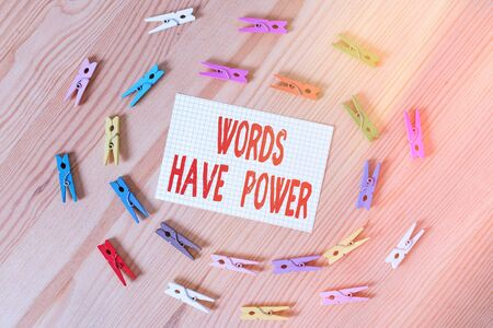 Text sign showing Words Have Power. Business photo text essential tools individuals use to communicate and learn Colored clothespin papers empty reminder wooden floor background office