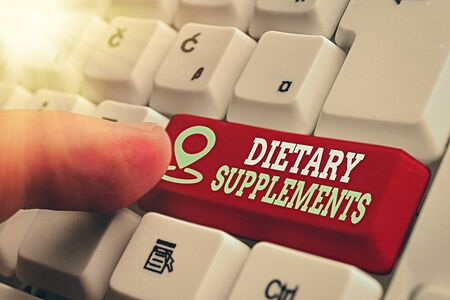 Word writing text Dietary Supplements. Business photo showcasing product intended to supplement the diet taken orally White pc keyboard with empty note paper above white key copy space