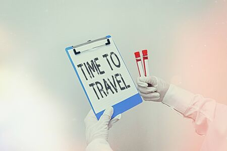 Conceptual hand writing showing Time To Travel. Concept meaning Collect moments Old ways won t open new doors. Let s is go explore. Laboratory blood test sample for medical diagnostic analysis