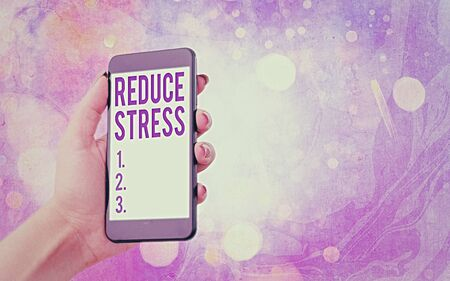 Text sign showing Reduce Stress. Business photo showcasing to lessen the state of mental or emotional strain or tension Modern gadgets with white display screen under colorful bokeh background
