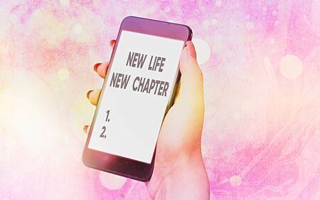 Text sign showing New Life New Chapter. Business photo showcasing modification of brand or business Change opportunities Modern gadgets with white display screen under colorful bokeh background