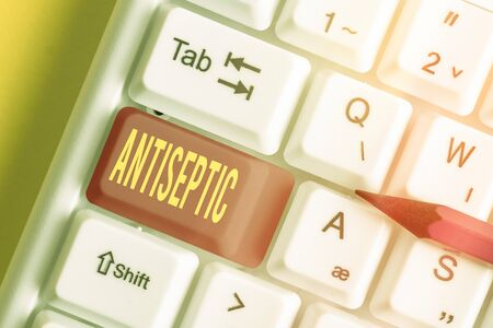 Writing note showing Antiseptic. Business concept for antimicrobial agents that delays or completely eliminate the microorganism White pc keyboard with empty note paper above white key copy space