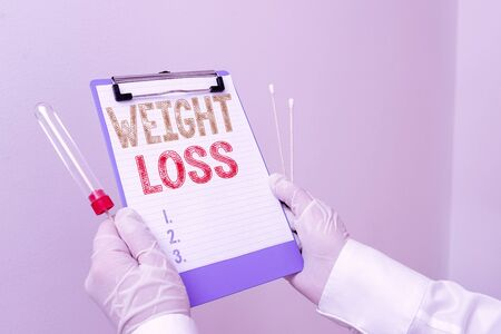 Text sign showing Weight Loss. Business photo showcasing a reduction of the total body mass due to a mean loss of fluid Laboratory blood test sample shown for medical diagnostic analysis result