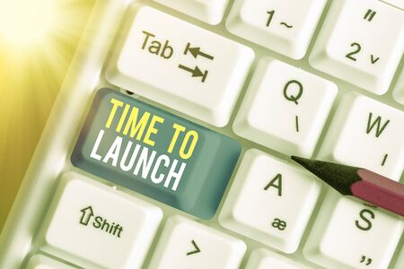 Text sign showing Time To Launch. Business photo text Business StartUp, planning and strategy, management, realization White pc keyboard with empty note paper above white key copy space