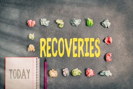 Word writing text Recoveries. Business photo showcasing process of regaining possession or control of something lost Paper accesories with digital smartphone arranged on different background