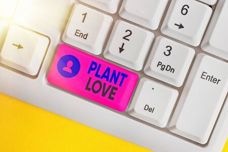 Conceptual hand writing showing Plant Love. Concept meaning a symbol of emotional love, care and support showed to others White pc keyboard with empty note paper above white key copy space