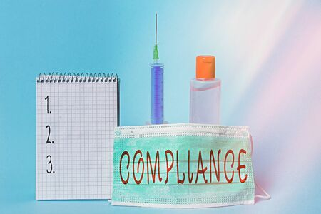 Conceptual hand writing showing Compliance. Concept meaning the action or fact of complying with a wish or commands Set of medical equipment with notepad for health assessment Stock Photo