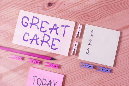 Word writing text Great Care. Business photo showcasing giving attention, consideration, love, and comfort towards others Colored clothespin papers empty reminder wooden floor background office Zdjęcie Seryjne