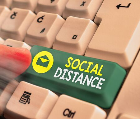 Text sign showing Social Distance. Business photo text maintaining a high interval physical distance for public health safety White pc keyboard with empty note paper above white key copy space