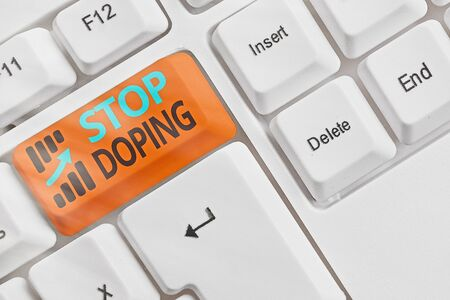 Handwriting text Stop Doping. Conceptual photo quit the use of banned athletic performanceenhancing drugs White pc keyboard with empty note paper above white key copy space