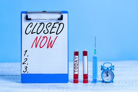 Text sign showing Closed Now. Business photo showcasing of a business having ceased trading especially for a short period Extracted blood sample vial with medical accessories ready for examination