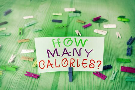 Conceptual hand writing showing How Many Calories Question. Concept meaning asking how much energy our body could get from it Colored crumpled rectangle shape paper light blue background