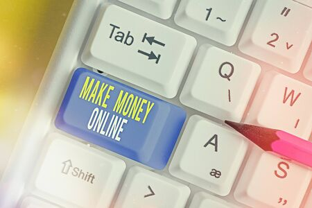 Text sign showing Make Money Online. Business photo text Get paid earn cash through freelancing and web marketing White pc keyboard with empty note paper above white key copy space
