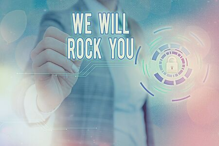 Writing note showing We Will Rock You. Business concept for to be going out and facing the world and all that is in it Graphics padlock for web data information security application system 免版税图像
