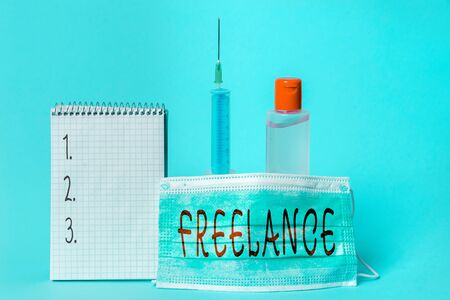 Conceptual hand writing showing Freelance. Concept meaning working at different firms rather than being permanently Set of medical equipment with notepad for health assessment Archivio Fotografico
