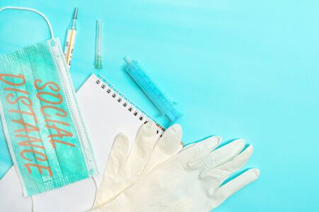 Conceptual hand writing showing Social Distance. Concept meaning maintaining a high interval physical distance for public health safety Set of medical equipment with notepad for health assessment