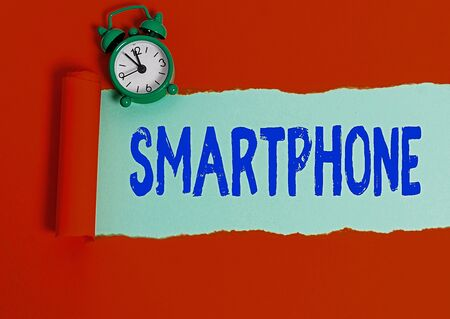 Text sign showing Smartphone. Business photo text a mobile phone that performs many of the computer s is features Rolled ripped torn cardboard placed above a wooden classic table backdrop