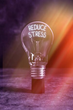 Text sign showing Reduce Stress. Business photo text to lessen the state of mental or emotional strain or tension Realistic colored vintage light bulbs, idea sign solution thinking concept Zdjęcie Seryjne