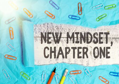 Handwriting text writing New Mindset, Chapter One. Conceptual photo change on attitudes and thinking Improve hard work Rolled ripped torn cardboard placed above a wooden classic table backdrop