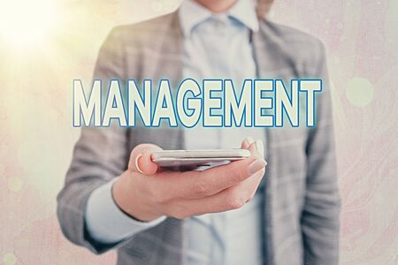 Conceptual hand writing showing Management. Concept meaning the authoritative act of directing or controlling things Touch screen digital marking important details in business