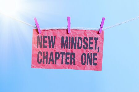 Handwriting text writing New Mindset, Chapter One. Conceptual photo change on attitudes and thinking Improve hard work Clothesline clothespin rectangle shaped paper reminder white wood desk