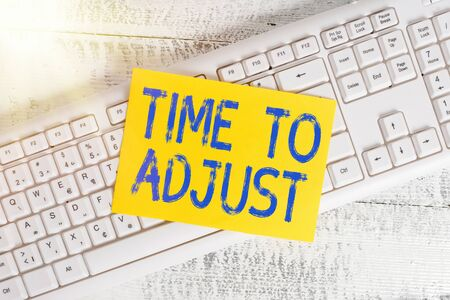 Handwriting text Time To Adjust. Conceptual photo making necessary or desirable changes to corresponding White keyboard office supplies empty rectangle shaped paper reminder wood Standard-Bild