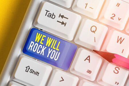 Text sign showing We Will Rock You. Business photo text to be going out and facing the world and all that is in it White pc keyboard with empty note paper above white key copy space