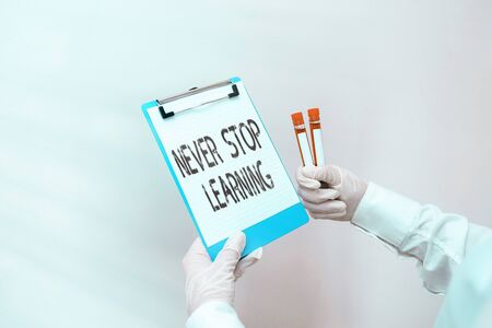 Conceptual hand writing showing Never Stop Learning. Concept meaning continuous education and techniques to be competitive Laboratory blood test sample for medical diagnostic analysis Standard-Bild