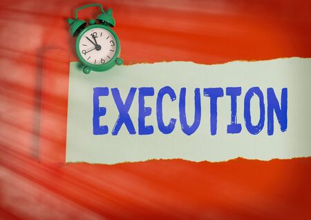 Text sign showing Execution. Business photo text it executes or imposes a program order or course of action Rolled ripped torn cardboard placed above a wooden classic table backdrop